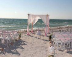Florida beach wedding dreams come true with blush chiffon at Pass-a-Grille beach - crafted by Suncoast Weddings and uniquely yours