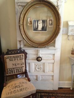 Empty antique frame on an old door becomes the perfect place to display my parent's wedding photo. I covered the old Eastlake chair in burlap coffee sacks from South America.