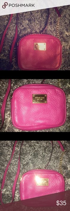 Michael Kors Leather Cross Body- Magenta Pre owned Michael Kors small square cross body bag in magenta. Leather is still in good condition, interior is clean, slight scratches on outside gold hardware. Michael Kors Bags Crossbody Bags