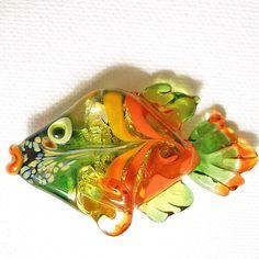 Bright, shiny orange lampwork glass fish pendant by isinglass design, via Flickr