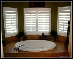 luxury bath with shutters