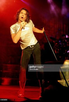 Michael Hutchence lead singer of Australian band INXS performs on stage at the Festhalle in Frankfurt, Germany on November 6 1990.