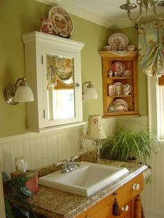 Love the corner shelves with the china in the bathroom.  Never would have thought of that.