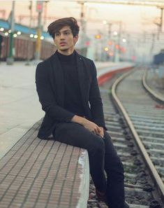 Image may contain: 1 person, sitting and outdoor You Are My Crush, India Actor, Musically Star, Mens Turtleneck, I Love Justin Bieber, Photography Poses For Men, Boy Poses, Cute Gif, Stylish Men
