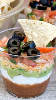 Individual Six-Layer Dip Cups Recipe ~ These Mexican-inspired individual dip cups recipe contain six delicious layers