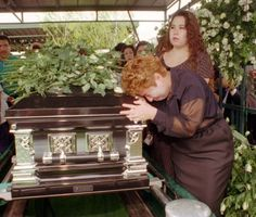 Lidia Castaneda weeps over the coffin of slain Tejano music star Selena during funeral services Monday, April 3, 1995, in Corpus Christi. / POOL AP