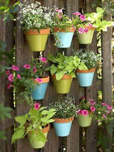 Flower pots on a fence