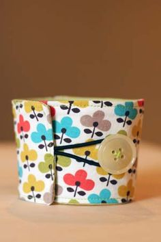 Clever idea. Fabric coffee sleeve tutorial by One Crafty Home. #sewing
