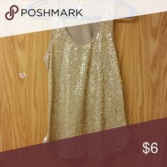 Gold tank Very pretty under a cardigan or jean jacket! No holes or stains! Great condition! :) Tops Tank Tops