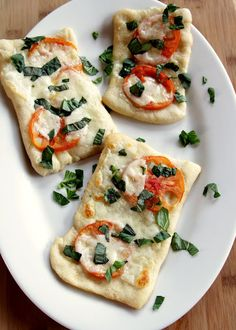 I love this fresh Caprice/Margarita flat bread. There is nothing more refreshing than fresh mozzarella, sweet basil,  tomatoes!