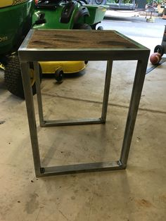 End table using reclaimed decking from a semi trailer.