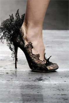 A pair of chic, sexy, black lace heels will make a real statement.