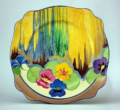 Clarice CLIFF 'Bizarre' Pansies plate. Hand-painted in bright colours. Burma.  (hva)