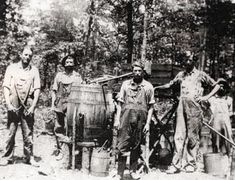 In an era when corn was plentiful and dollars were not, Rabun County men, like their neighbors in all of Georgia and much of Appalachia, turned to the production and selling of moonshine to put food on the table for their families.