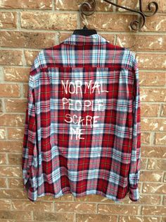 Flannel shirt has been hand painted Soft and comfy! Black, blue, cranberry and white Made from an xxl shirt Would fit oversized large to