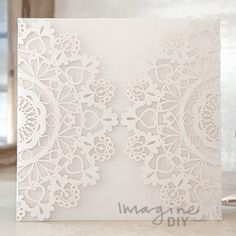 Enchante Laser Cut Range in White  Laser cut wedding invitations perfect for your luxury wedding. DIY laser cuts are easy and elegant with options to insert your own printer inserts.
