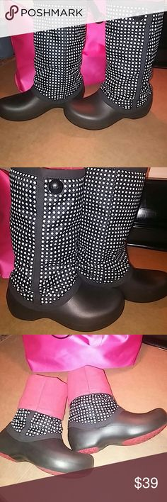 CROCS insulated rain boots size 7M black/white CROCS size 7M with white polka dots that adds spice and flirt to walking in the rain. You'll be cute and dry wearing your CROC rain boots.....smoke free home.... Very gently used condition. crocs Shoes Winter & Rain Boots