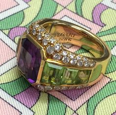 This iconic 1980s Bulgari ring with amethyst, peridot and diamonds is a perfect example of Bulgari's famous use of color.