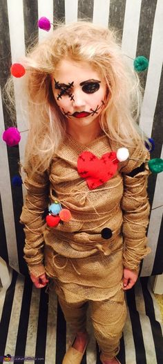 My daughter came up with the idea after last years halloween. She decided to be a voodoo doll. We used burlap, wooden dowels, Pom poms, hot glue gun, safety pins and twine to compete the look. We also used basic makeup; eyeliner, eyeshadow and lipstick. Photo 2 of 4.