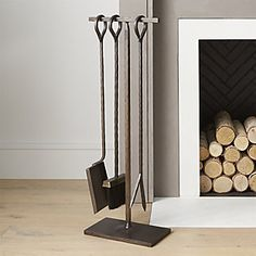 crz: for library fireplace Antiqued Brass Fireplace Tool Set. Hammered texture, traditional looped handles and a warm antiqued brass finish lend rustic appeal to our simply styled fireplace poker, brush and shovel handcrafted of wrought and sheet iron. Fireplace Poker, Wooden Fireplace, Fireplace Tool Set, Black Fireplace, Fireplace Screens, Home Fireplace, Fireplace Hearth, Fireplace Remodel, Farmhouse Fireplace Tools