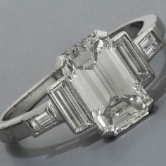 Art Deco Engagement Ring - I'm not at all opposed to thin side stones like that.