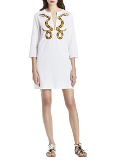 Washed cotton voile three-quarter length sleeve women's tunic in clean white with hook-and-eye front closure and hand-embroidered signature snake detail. Includes a fabric belt and can be worn as a dress or over a pair of jeans.  Made in India  100% Cotton Voile  Dry clean