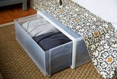 """Small-Space Makeover: A 400-Square-Foot Apartment –SMALL-SPACE TIP #9: MAXIMIZE FORGOTTEN SPACES """"For a tiny bedroom, under-bed storage equates to extra closet space,"""" Andrew says. """"Use pullout bins to stow away not-in-use winter clothes and blankets. They can stay out of sight under the bed, but they're still easy to access."""""""