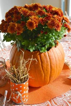Cut a wide enough hole at the top of a fake pumpkin and fill with flowers (real or fake).  Perfect fall centerpiece for the dining table