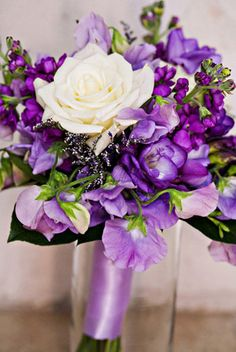 Purple bridesmaid bouquet including stock, freesia, sweet pea, eskimo rose and misty limonium
