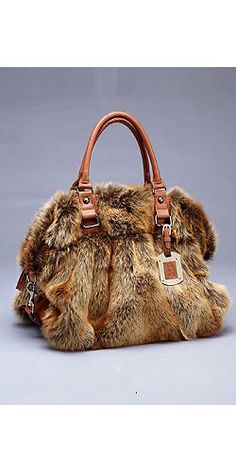 Lions and Tigers and Bears ohh myy! bring out your wild side with this faux fur handbag!    -Faux Coyote Fur Satchel-