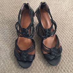 """LOFT black strappy wedge w/details, wood look heel LOFT black strappy wedge w/details, wood look heel. 4"""" wedge with 1"""" platform area near toe. Comfortable even with the zipper at the back, there is leather to protect you from the zipper! These are the PERFECT summer wedge with lots of great details 😍 LOFT Shoes Wedges"""