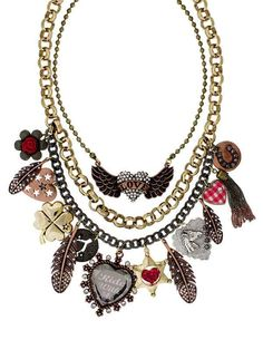 A necklace from Betsey Johnson, her jewelry is very layered with many small details and accessories.