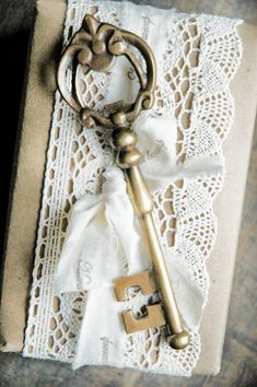 If the key was smaller, tied in with the bow and the box was an invitation this would be beautiful