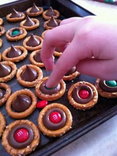 Quick and easy holiday treat - try using Rolos candies and press down while they're still warm to get them to stick to the pretzel ring. Delicious!