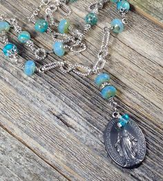 A personal favorite from my Etsy shop https://www.etsy.com/listing/505746308/french-miraculous-medal-necklace