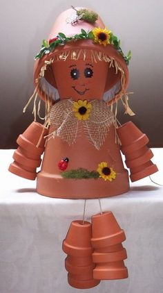 Clay Pot Girl - love the idea of the clay pot hat Flower Pot Art, Clay Flower Pots, Flower Pot Crafts, Clay Pot Projects, Clay Pot Crafts, Diy Clay, Flower Pot People, Clay Pot People, Painted Clay Pots