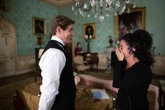 """The expressions say it all: Allen Leech and a crew member on the set of """"Downton Abbey."""""""