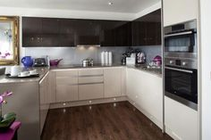 KITCHEN IDEAS (DARK FLOORING - CONTRASTING CUPBOARD DOOR COLOURS / FLOOR SPOTLIGHTS) - A Typical Taylor Wimpey Showhouse Kitchen