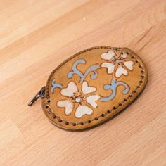 Sweet flower and vine leather coin purse.  Made in USA by Moxie & Oliver.