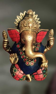 Brass and Stone Sculpture of Lord Ganesha with an OM symbol