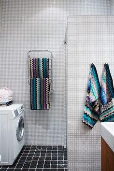 A Bathroom With A Chevron Floor Missoni Bathroom Designs And Towels - Missoni black and white bath mat for bathroom decorating ideas