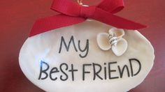 Christmas ornament for your best friend created using a seashell.  Drill a hole and attach a wire for hanging, add a ribbon, create and attach a seashell flower and you're all set.  Or you can check mine out on my etsy site SharingSeaShells.