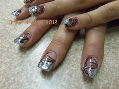 Sliver cheetah glitter acrylic nails with some painting to them .