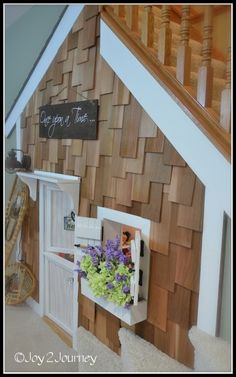 """- Adorable """"cottage"""" playhouse under the stairs"""