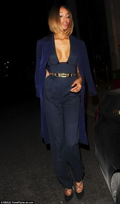 Statement look! Jourdan wore a striking pinstriped jumpsuit with a very plunging neckline