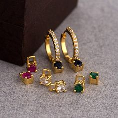 Dazzle around in the party with these versatile gold-plated huggie hoop earrings that feature different colour changeable CZ studs to match your look. Wear them with or without the studs on any dress of your choice Gold Ring Designs, Gold Earrings Designs, Gold Jewellery Design, Gold Jewelry, Gold Necklace, Necklace Designs, Jewelry Necklaces, Indian Artificial Jewellery, Indian Jewelry