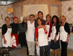 A group of students pose with Chef Carmen after their cooking class on the Amalfi Coast. #foodandtravel