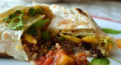 Quinoa Mango Black Bean Burrito with Mango Salsa.  A snack, brunch or lunch that hits all the right taste notes: salty, sweet, warm, cool, smooth, crunchy... fast, easy, delish, and healthy.