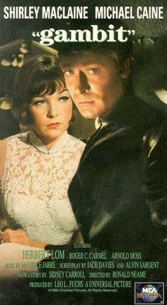 Shirley MacLaine, Michael Caine, Herbert Lom. Director: Ronald Neame. IMDB: 7.2 _________________________ http://en.wikipedia.org/wiki/Gambit_(1966_film) http://www.rottentomatoes.com/m/gambit/ http://www.tcm.com/tcmdb/title/75918 Article: http://www.tcm.com/tcmdb/title/75918/Gambit//Gambit/  http://www.allmovie.com/movie/gambit-v19144