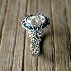 Yehuda Diamond Engagement Ring in Platinum with Teal Turquoise Blue Diamonds in Fine Vine Setting Size 6 by AdziasJewelryAtelier on Etsy https://www.etsy.com/listing/162453084/yehuda-diamond-engagement-ring-in